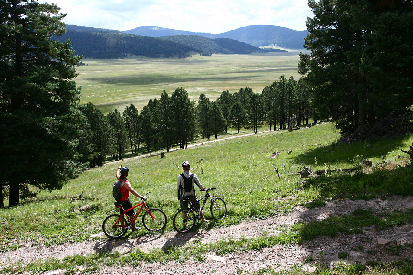 Mountain bikers stop to admire the Valle Grande | Photo by: NPS